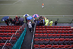Supporters of Irish club Bohemians making their way to their seats at Park Hall Stadium, Oswestry before their team's Champions League 2nd qualifying round 2nd leg game away to The New Saints. Despite leading 1-0 from the first leg, the Dublin club went out following their 4-0 defeat by the Welsh champions. The match was the first-ever Champions League match in the UK played on an artificial pitch and was staged at the Welsh Premier League's ground which was located over the border in England.