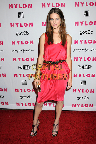 LYNDSY FONSECA.Nylon Magazine's Young Hollywood Party held at the Roosevelt Hotel's Tropicana Bar, Hollywood, California, USA..May 12th, 2010.full length black belt pink dress gold silver t-bar sandals peep toe shoes clutch bag .CAP/ADM/BP.©Byron Purvis/AdMedia/Capital Pictures.