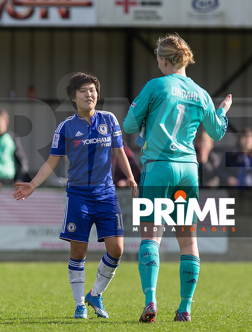 Ji So-Yun of Chelsea Ladies & Goalkeeper Hedvig Lindahl of Chelsea Ladies celebrate the victory during the Women's FA Cup Semi Final match between Chelsea Ladies and Manchester City Women at Wheatsheaf Park, Staines, England on 17 April 2016. Photo by Andy Rowland.