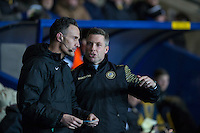 Millwall Manager Neil Harris talks with fourth official Darren Deadman during the Johnstone's Paint Trophy Southern Final 2nd Leg match between Oxford United and Millwall at the Kassam Stadium, Oxford, England on 2 February 2016. Photo by Andy Rowland / PRiME Media Images.