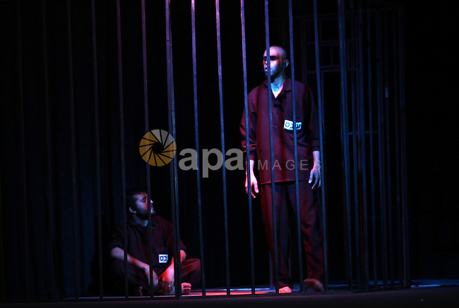 "Palestinian actors perform in the play ""Freedom sings"" in Gaza city on April 15, 2013. The play organised by Waed society, talks about the the life of Palestinian prisoners in Israeli jails and the Palestinian resistance, ahead of Palestinian prisoners day on April 17. Photo by Ashraf Amra"