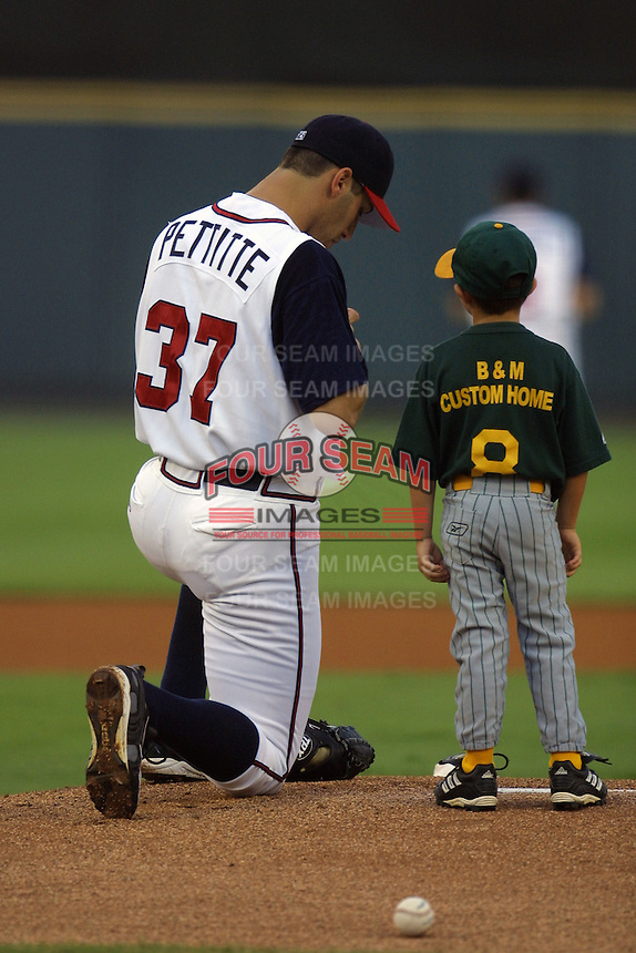 Houston Astros pitcher Andy Pettitte (37) signs an autograph for a young fan before his second rehab start with the Round Rock Express of the Texas League on June 23, 2004 at the Dell Diamond in Round Rock, Texas. (Andrew Woolley/Four Seam Images)