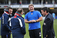 The Bath Rugby coaches share a joke during the pre-match warm-up. European Rugby Champions Cup match, between Bath Rugby and Glasgow Warriors on January 25, 2015 at the Recreation Ground in Bath, England. Photo by: Patrick Khachfe / Onside Images