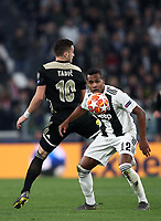 Football Soccer: UEFA Champions UEFA Champions League quarter final second leg Juventus - Ajax, Allianz Stadium, Turin, Italy, March 12, 2019. <br /> Juventus' Alex Sandro (r) in action with Ajax's Dusan Tadic (l) during the Uefa Champions League football match between Juventus and Ajax  at the Allianz Stadium, on March 12, 2019.<br /> UPDATE IMAGES PRESS/Isabella Bonotto