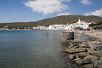 A view of Cadaques, famous for its whitewashed facades of village houses, huddled together beneath the spare exterior of the Church of Santa Maria