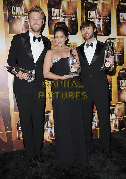 LADY ANTEBELLUM - Charles Kelley, Hillary Scott, Dave Haywood.4th Annual CMA Awards, Country Music's Biggest Night, held at Bridgestone Arena, Nashville, Tennessee, USA, 10th November 2010 ..press room  CMAs country music full length band group winners trophies tuxedo tux bow tie strapless dress long maxi .CAP/ADM/GS.©George Shepherd/AdMedia/Capital Pictures.