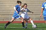 Torrance, CA 02/08/10 - West's Courtney Diaz (West #5) foots the ball as Leuzinger's Maciel Gonzalez (Leuzinger #12) defends her.