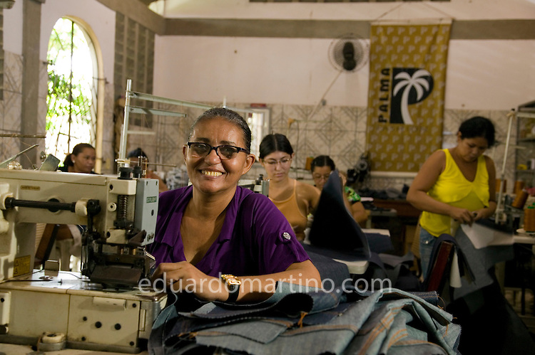 Maria Dacilia De Lima Silva, Palmafashion's manager, in their factory at the back of Palma Bank's premises..Conjunto Palmeiras, Fortaleza, Ceara, Brazil.Photo: Eduardo Martino / Documentography