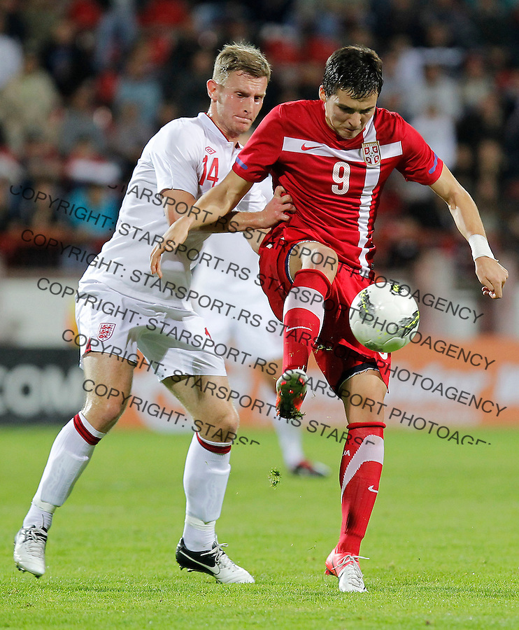 Fudbal .Serbia U21 v England U21.play off second leg revans mec.Djordje Despotovic and Tom Lees left.Krusevac, 16.10.2012..foto: Srdjan Stevanovic/Starsportphoto ©
