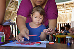 Arbicelica Aguilar helps her 3-year old daughter Frida Yoselin Vaughan during a session of the early intervention program of Piña Palmera, a center for community based rehabilitation for people living with disabilities in Zipolite, a town in Oaxaca, Mexico. The girl lives with some developmental disability.
