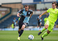 Michael Harriman of Wycombe Wanderers on the ball under pressure from Dan Jones of Hartlepool United during the Sky Bet League 2 match between Wycombe Wanderers and Hartlepool United at Adams Park, High Wycombe, England on 5 September 2015. Photo by Andy Rowland.