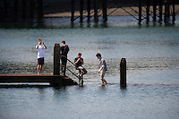 Aberystwyth Wales Uk, Sunday 08 May 2016<br /> Pictured: Young men stand about one of the jetties.<br /> UK Weather : As temperatures reach the upper 20's centigrade in parts of Britain, people enjoy the warm May sunshine in Aberystwyth on the Cardigan Bay coast in West Wales.