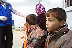 Raba'a Al Sarhan Transit Center (RSTC), Mafraq Governorate,  Jordan, March 8th, 2014 : Polio vaccination for newly arrived Syrian refugees at the RSTC. New arrivals are processed by IOM teams. All children under 16 are immunized against polio, while all refugees are vaccinated against measles. The RSTC is only 10 km from the Syrian border.<br /> The new arrivals crossed from Syria only a few hours ago and will be placed in Za'atari refugee camp after processing and health screening. Over 400 arrived today.<br /> Mafraq Governorate covers one fifth of Jordan and border Syria, Iraq and Saudi Arabia. It has a population of 306,000 jordanians plus 400,000 syrian refugees. (Photo by Jean-Marc Giboux)