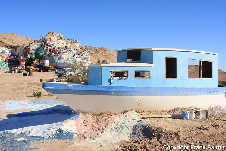 Boat at Salvation Mountain in desert