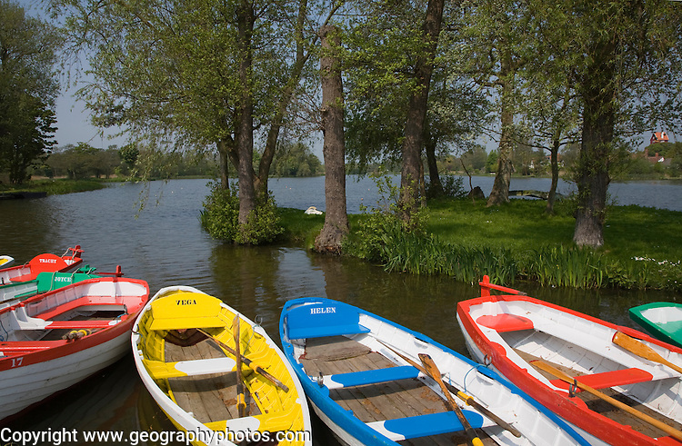 Colourful rowing boats on the Meare at Thorpeness, Suffolk, England