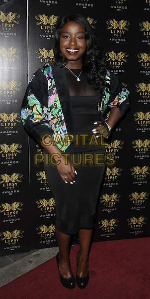 Misha B (Misha Bryan)<br /> The Lipsy VIP Fashion Awards 2013, DSTRKT, Rupert St., London, England.<br /> May 29th, 2013<br /> full length black dress green print jacket hand on hip  <br /> CAP/CAN<br /> &copy;Can Nguyen/Capital Pictures