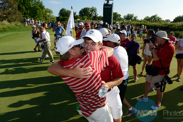 28 MAY 2014: Robby Shelton of the University of Alabama celebrates with teammates and coaches after winning the match play at the 2014 NCAA D1 Men's Golf Championship at Prairie Dunes in Hutchinson, KS. <br />