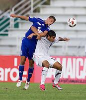 Mario Rodriguez (9) of the United States and Emmanual Labrada (3) of Cuba fight for a header during the first day of the group stage at the CONCACAF Men's Under 17 Championship at Catherine Hall Stadium in Montego Bay, Jamaica. The United States defeated Cuba, 3-1.