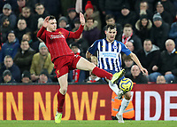 30th November 2019; Anfield, Liverpool, Merseyside, England; English Premier League Football, Liverpool versus Brighton and Hove Albion; Andy Robertson of Liverpool and Lewis Dunk of Brighton and Hove Albion compete for the ball  - Strictly Editorial Use Only. No use with unauthorized audio, video, data, fixture lists, club/league logos or 'live' services. Online in-match use limited to 120 images, no video emulation. No use in betting, games or single club/league/player publications