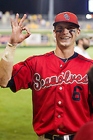 "Stony Brook Seawolves outfielder Travis Jankowski #6 smiles and signals ""the O"" following the NCAA Super Regional baseball game against LSU on June 10, 2012 at Alex Box Stadium in Baton Rouge, Louisiana. Stony Brook defeated LSU 7-2 to advance to the College World Series in Omaha. (Andrew Woolley/Four Seam Images)"