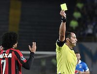 BOGOTA - COLOMBIA -08 -02-2017: Julio Bascuñan (CHI), arbitro, muestra la tarjeta amarilla a Otavio de Paranaense durante partido entre Millonarios de Colombia y Atletico Paranaense de Brasil, por la segunda fase, llave 1 de la Copa Conmebol Libertadores Bridgestone 2017 jugado en el estadio Nemesio Camacho El Campin, de la ciudad de Bogota. / Julio Bascuñan (CHI), referee, swows the yellow card to Otavio of Paranaense during a match between Millonarios of Colombia and Atletico Paranaense of Brasil, for the second phase, key1, of the Conmebol Copa Libertadores Bridgestone 2017 played at Nemesio Camacho El Campin in Bogota city. Photo: VizzorImage / Gabriel Aponte / Staff.