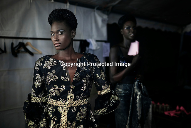 DAKAR, SENEGAL - JUNE 21: A model waits backstage before a fashion show with the Tunisian designer label Fanzy Couture at Dakar Fashion Week on June 21, 2014, at Hotel des Almadies in Dakar, Senegal. Seventeen Senegalese, African and foreign based designers showed their collections during the 12th edition of Dakar Fashion week. (Photo by Per-Anders Pettersson)