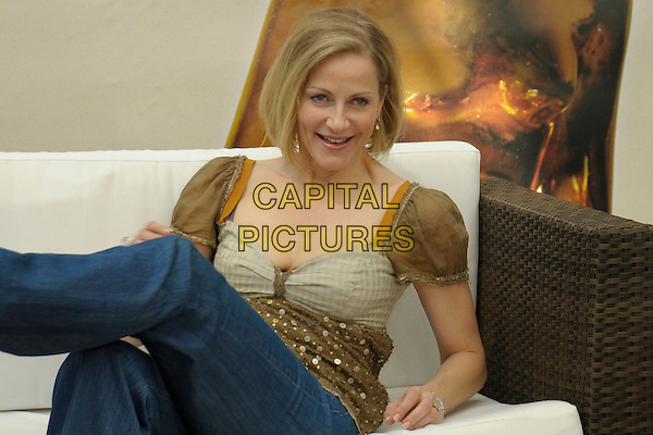 BABSIE STEGER.Photocall during the 49th Monte Carlo Television Festival at the Grimaldi Forum, Monte-Carlo, Monaco..June 10th, 2009 .half length gold brown sequins sequined top sitting couch sofa .CAP/RD.©Richard Dean/Capital Pictures.