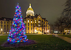 Dec. 3, 2015; Christmas tree and Main Building. (Photo by Barbara Johnston/University of Notre Dame)