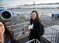 Erin Kim '23 boards her flight at Burbank Airport.<br /> Eleven Occidental College first-years and sophomores traveled with Career Services staff and Senior Associate Dean of Students Erica O'Neal Howard to San Francisco for a day to visit Cambridge Associates, managers of Oxy's endowment, as part of their workforce diversity initiative. They were invited to meet with employees (including two alums), tour the office, and learn about careers in investment management. Students were able to see how their quantitative courses could be applied to future career opportunities.<br /> January 17, 2020.<br /> (Photo by Marc Campos, Occidental College Photographer)