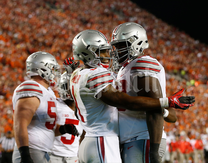 Ohio State Buckeyes wide receiver Braxton Miller (1) celebrates with Ohio State Buckeyes offensive lineman Chase Farris (57) after scoring a touchdown in the third quarter during Monday's NCAA Division I football game against the Virginia Tech Hokies in Blacksburg, Va., on September 7, 2015. The Hokies led 28-17 in the third quarter (Dispatch Photo by Barbara J. Perenic)