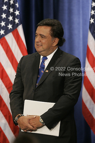 Chicago, IL - December 3, 2008 -- United States Secretary of Commerce designee and New Mexico Governor Bill Richardson waits to be introduced by United States President-elect Barack Obama at news conference in Chicago on December 3, 2008. .Credit: Brian Kersey - Pool via CNP
