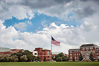 The American flag flies on a cloudy summer day over Mississippi State University's historic Drill Field. For the second year in a row, MSU has earned recognition as a &ldquo;Great College to Work For&rdquo; from The Chronicle of Higher Education for receiving top ratings from employees on workforce practices and policies. From protecting aircraft from lightning strikes to designing an all-electric Navy ship to strengthening Mississippi&rsquo;s teacher workforce, MSU leaders are thinking beyond boundaries to build a better future.<br />  (photo by Megan Bean / &copy; Mississippi State University)