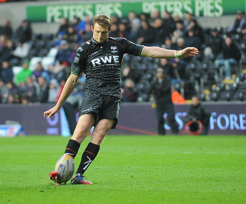 Ospreys' Dan Biggar converts his sides fourth try <br /> <br /> Photo by Kevin Barnes/CameraSport<br /> <br /> Rugby Union - RaboDirect PRO12 - Ospreys v Connacht - Saturday 10th May 2014 - Liberty Stadium - Swansea<br /> <br /> &copy; CameraSport - 43 Linden Ave. Countesthorpe. Leicester. England. LE8 5PG - Tel: +44 (0) 116 277 4147 - admin@camerasport.com - www.camerasport.com