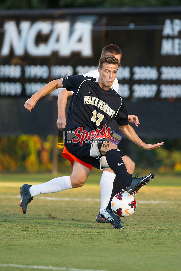 Andy Lubahn (17) of the Wake Forest Demon Deacons gets position on Kevin McBride (15) of the Virginia Cavaliers during first half action at Spry Soccer Stadium on September 13, 2013 in Winston-Salem, North Carolina.  The Demon Deacons defeated the Cavaliers 3-2.  (Brian Westerholt/Sports On Film)