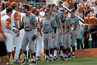 Texas A&M Aggies and Texas Longhorns line up for the post game handshake follow the NCAA baseball game on April 29, 2012 at UFCU Disch-Falk Field in Austin, Texas. The Longhorns beat the Aggies 2-1 in the last ever regular season game scheduled for the long time rivals. (Andrew Woolley / Four Seam Images)