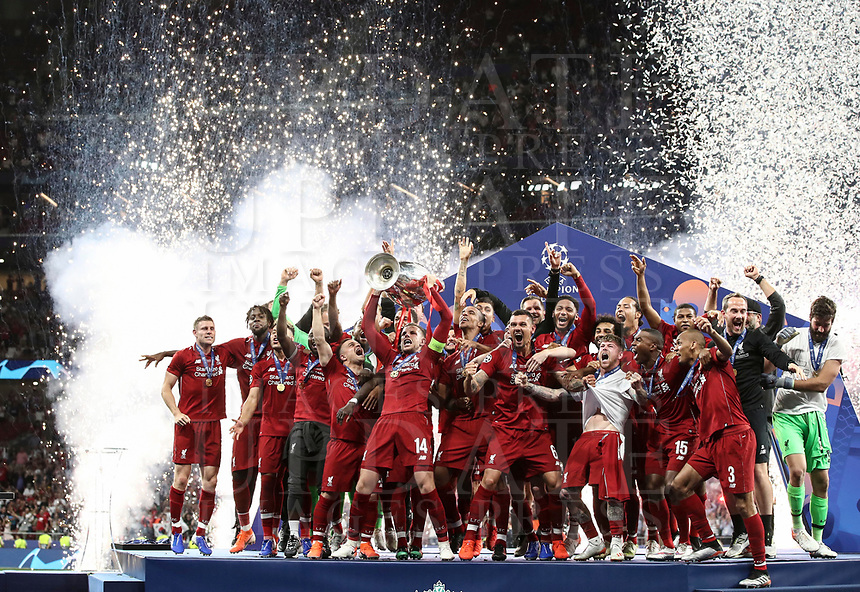 Liverpopol's captain Jordan Henderson, center, holds up the trophy at the end of the UEFA Champions League final football match between Tottenham Hotspur and Liverpool at Madrid's Wanda Metropolitano Stadium, Spain, June 1, 2019. Liverpool won 2-0.<br /> UPDATE IMAGES PRESS/Isabella Bonotto