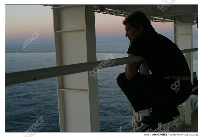 LCDR Kathy Grudzien, RN in the wards, takes a moment to watch the sunset. USNS COMFORT Naval hospital ship in the Persian Gulf.
