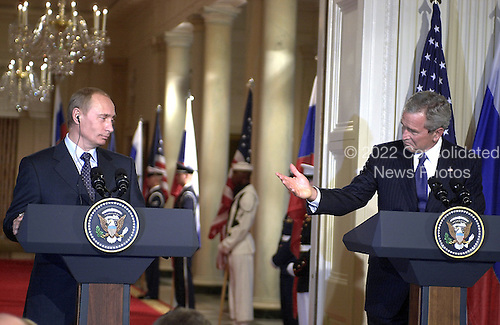 Washington, D.C. - September 16, 2005 -- United States President George W. Bush, right, and President Vladimir Putin of the Russian Federation, left, hold a joint press conference in the East Room of the White House in Washington, D.C. on September 16, 2005 after their bi-lateral talks..Credit: Ron Sachs / CNP