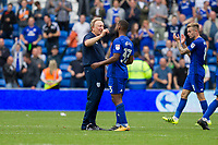Cardiff City manager Neil Warnock celebrates with his player Junior Hoilett after the Sky Bet Championship match between Cardiff City and Aston Villa at the Cardiff City Stadium, Cardiff, Wales on 12 August 2017. Photo by Mark  Hawkins / PRiME Media Images.