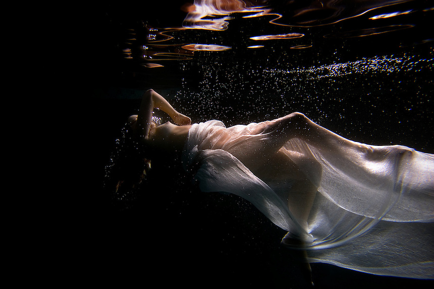 An underwater portrait of a woman in San Diego, California. A female underwater fashion model.