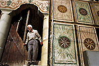 MACEDONIA. Tetovo. 01 August 2001..An Albanian leaves the main Mosque in Tetovo after afternoon prayer. This town is majority Albanian and has been the scene of recent heavy fighting between ethnic Albanian rebels and Government forces..©Andrew Testa