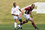 11 November 2008: NC State's Kris Byrd (9) and Virginia Tech's Taylor Walsh (23). North Carolina State University Wolfpack defeated the Virginia Tech Hokies 3-1 at Koka Booth Stadium at WakeMed Soccer Park in Cary, NC in a men's ACC tournament first round game.