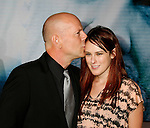 """HOLLYWOOD, CA. - September 24: Bruce Willis and Rumer Willis arrive at the Los Angeles premiere of """"Surrogates"""" at the El Capitan Theatre on September 24, 2009 in Hollywood, California."""