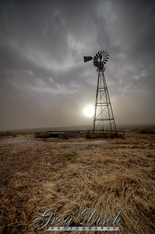 A dust storm at Point of Rocks, in the Cimarron National Grassland, near Elkhart Kansas, serves as a reminder of the Dust Bowl or the Dirty Thirties.<br /> Years of cattle grazing and farming, followed by a drought, degraded the soils and made them unproductive. By the 1930s many acres were barren. The strong winds that blow across the prairie swept up the loose soil, creating huge dust and sand storms. This area was part of the Dust Bowl, an area that covered parts of Kansas, Oklahoma, and Texas, named for the great dust storms. Morton County, where part of Cimarron National Grassland is, was one of the most devastated areas.<br /> <br /> <br /> The U.S. government wanted to stabilize the soil so the land could be used again for agriculture. Healthy grasslands reduce soil erosion and water runoff and provide a dependable supply of summer forage for livestock and wildlife. The U.S. Congress approved the Bankhead-Jones Farm Tenant Act in 1937, allowing the government to buy some of this unproductive land with loose soil. The land was first administered by the U.S. Soil Conservation Service and in 1954 was turned over to the U.S. Department of Agriculture Forest Service. The former Point of Rocks Ranch became Cimarron National Grassland in 1960. It is the largest tract of public land in Kansas.
