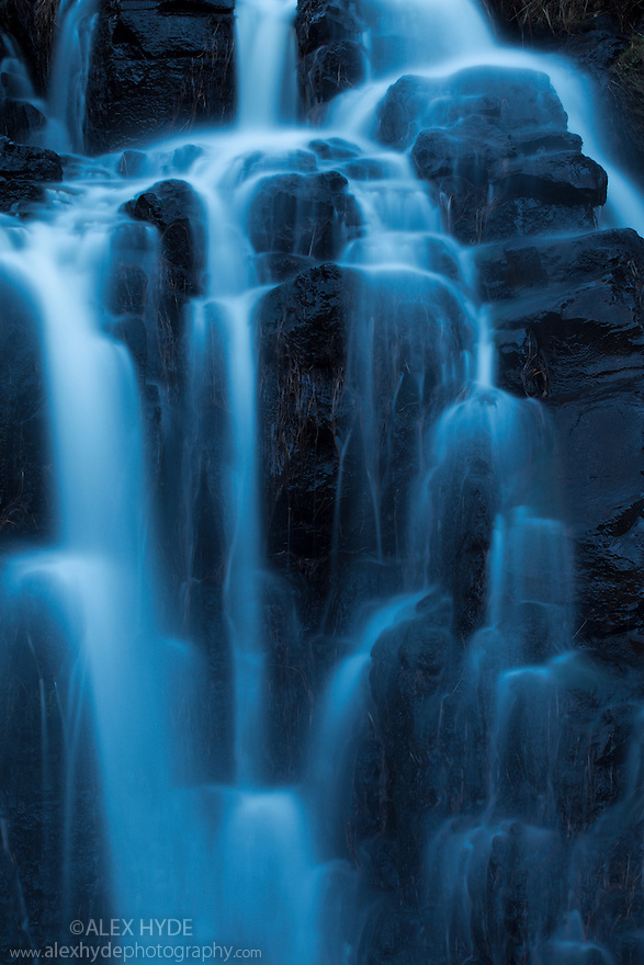Waterfall flowing down from the Cullin Hills, Isle of Skye, Inner Hebrides, Scotland, UK.