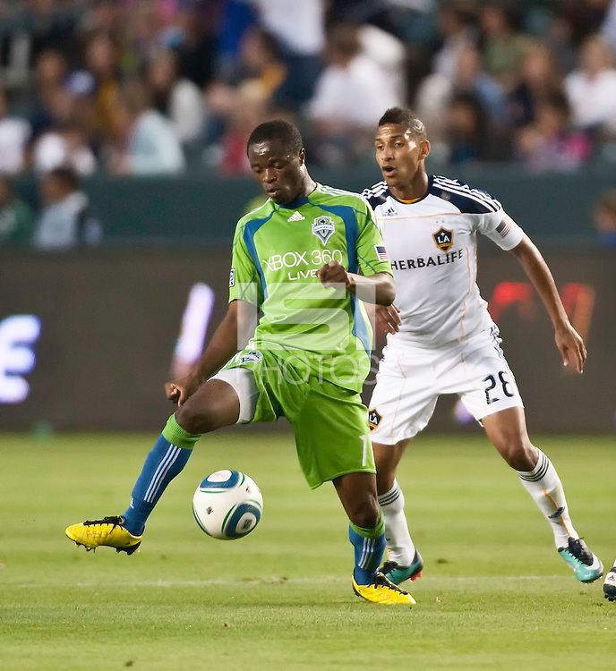 Seattle Sounders midfielder Steve Zakuani (11) receives the ball as LA Galaxy defender Sean Franklin (28) marks his man during the first half of the game between LA Galaxy and the Seattle Sounders at the Home Depot Center in Carson, CA, on July 4, 2010. LA Galaxy 3, Seattle Sounders 1.