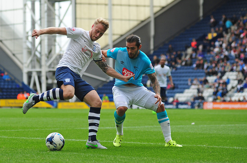 Preston North End's Tom Clarke shields the ball from Derby County&rsquo;s Bradley Johnson<br /> <br /> Photographer Chris Vaughan/CameraSport<br /> <br /> Football - The Football League Sky Bet Championship - Preston North End v Derby County - Saturday 12th September 2015 -  Deepdale - Preston<br /> <br /> &copy; CameraSport - 43 Linden Ave. Countesthorpe. Leicester. England. LE8 5PG - Tel: +44 (0) 116 277 4147 - admin@camerasport.com - www.camerasport.com