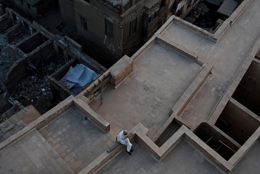 A man sits on the roof of a mosque in Cairo's Khan al Kalili district, June 2012. Photo: Ed Giles.