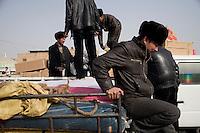 Truck drivers load a shipment at the Grand Bazaar in Kashgar, Xinjiang, China.  Kashgar has long been a major stop on the Silk Road.