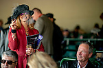 November 3, 2018 : A woman smokes a cigar on Breeders Cup World Championships Saturday at Churchill Downs on November 3, 2018 in Louisville, Kentucky. ///Eclipse Sportswire/CSM